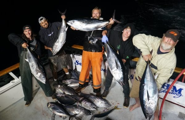 Group of friends fishing for Blue Fin Tuna
